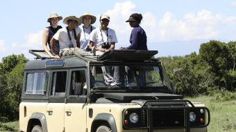 Students on jeep in Africa